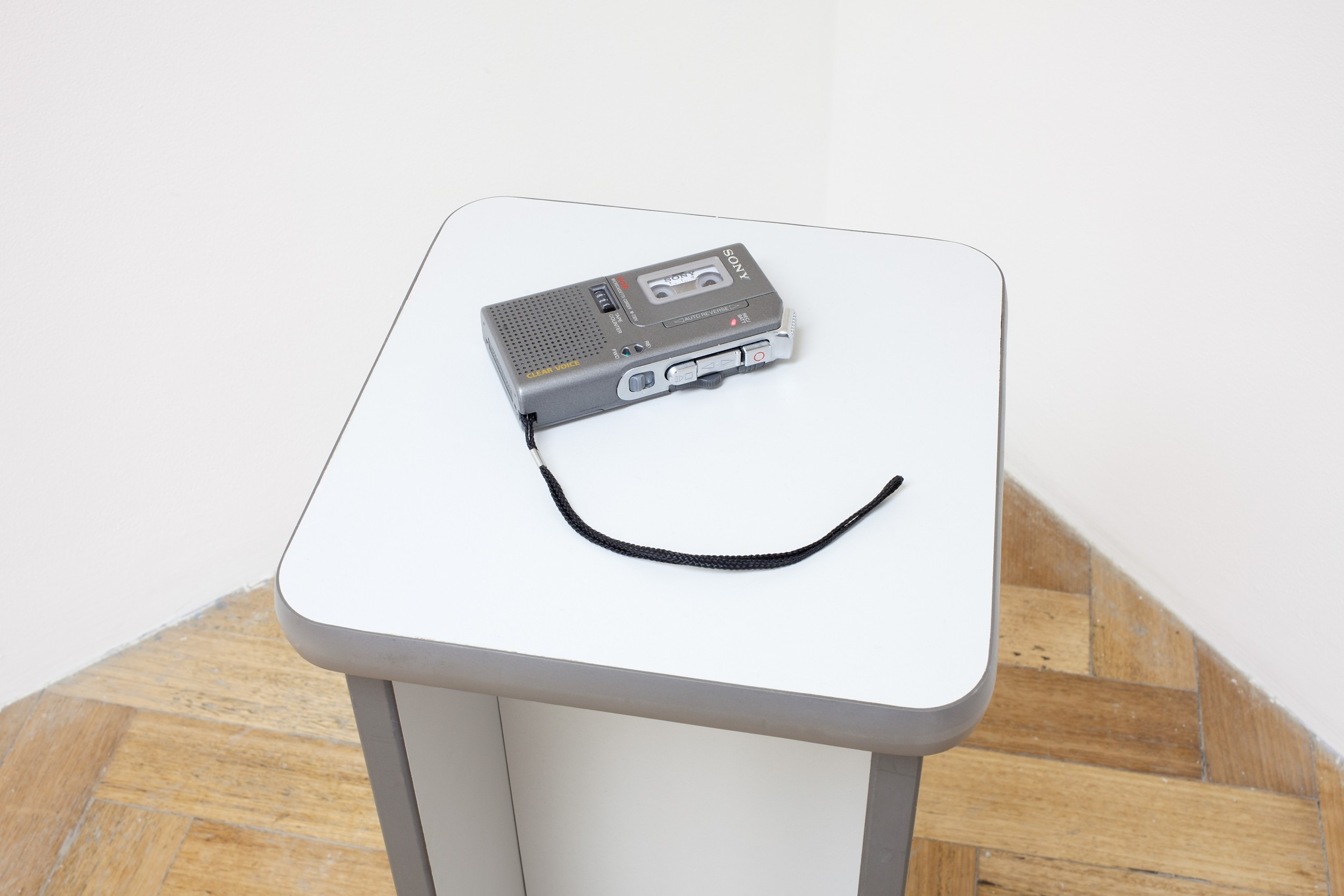 Steve Miller Reads Who Moved My Cheese?, 2013. Voice recording on microcassette, 46′25″, looped. Microcassette recorder on modified office desk, 74 x 25 x 25 cm Installation view, Having Cheese Makes You Happy, West Space, Melbourne, VIC, Australia, Jun-Jul 2014